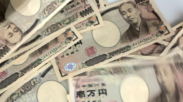 conteggio yen giapponese. - conto corrente video stock e b–roll
