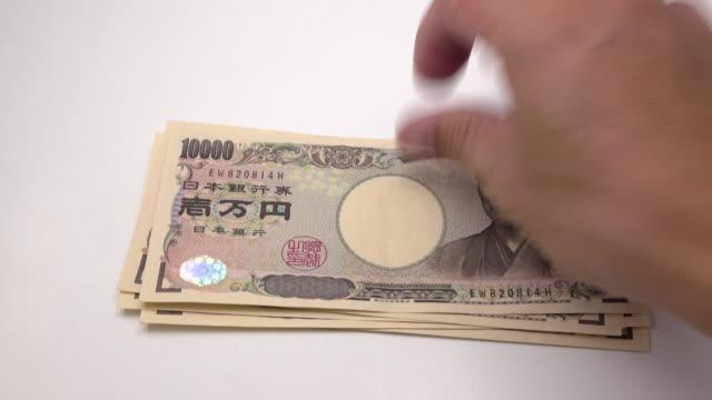 stockvideo's en b-roll-footage met tellen van de japanse yen - yenteken