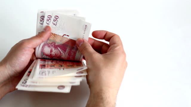 counting money full hd - pound sterling isolated bildbanksvideor och videomaterial från bakom kulisserna