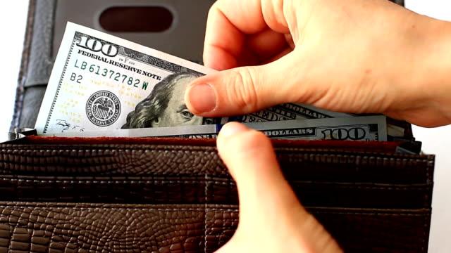 計數的錢包裡的錢 - 銀包 個影片檔及 b 捲影像