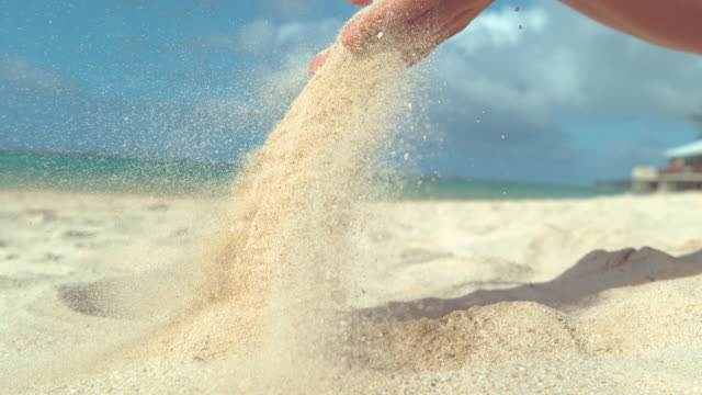 close up: countless grains of white sand fly across beach in the summer breeze. - exotic stock videos & royalty-free footage