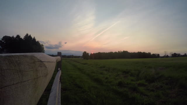 Country Farmland Timelapse with Fence during Sunset