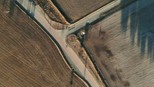 country road from above - сельская дорога стоковые видео и кадры b-roll