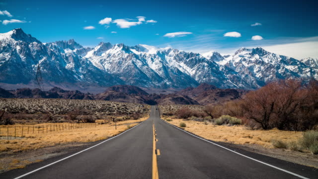 Country Road leading to Sierra Nevada Mountains in California video