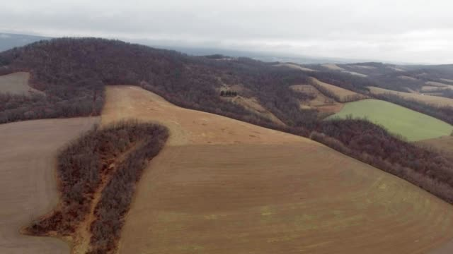 Country side of rolling hills in the fall aerial video