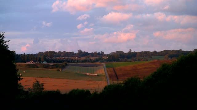 countryside cloudscape Beautiful countryside landscape in France in the region of Normandie normandy stock videos & royalty-free footage