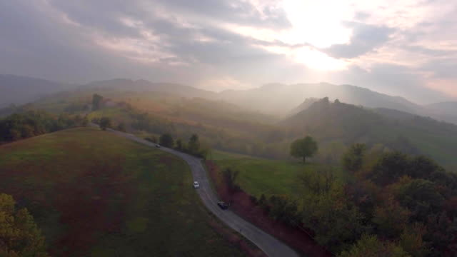 countryside road aerial view - strada tortuosa video stock e b–roll