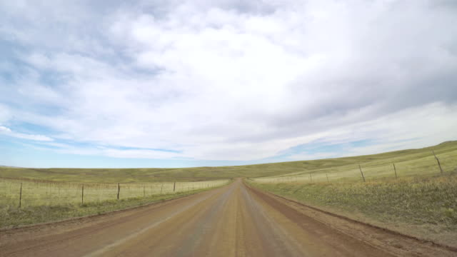 Countryside POV point of view - Driving through countryside in Eastern Colorado. country road stock videos & royalty-free footage