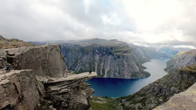 Coupe standing on the edge - Trolltunga, Norway video