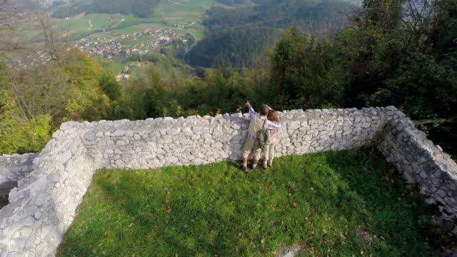 Couple admiring the view from castle ruins