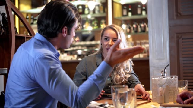 Couple argue in the restaurant Couple argue in the restaurant relationship breakup stock videos & royalty-free footage