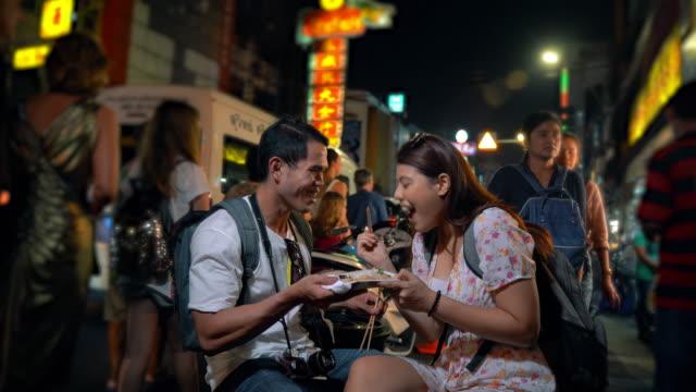 Couple Asia tourist enjoy travel at china town Bangkok Thailand