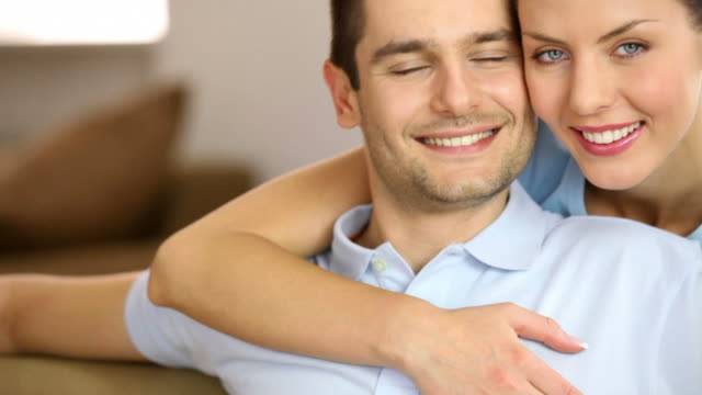 hd couple at home, smiling, embracing - heterosexual couple stock videos and b-roll footage
