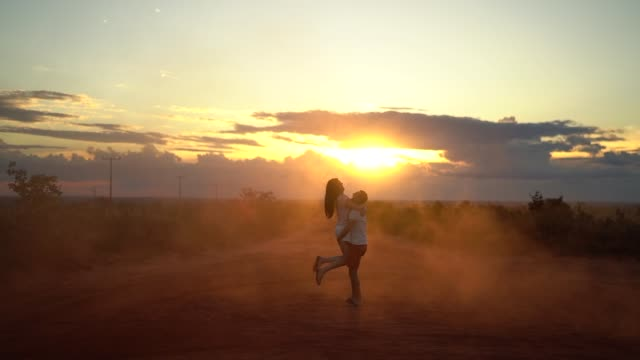 Couple at road trip on sunset time