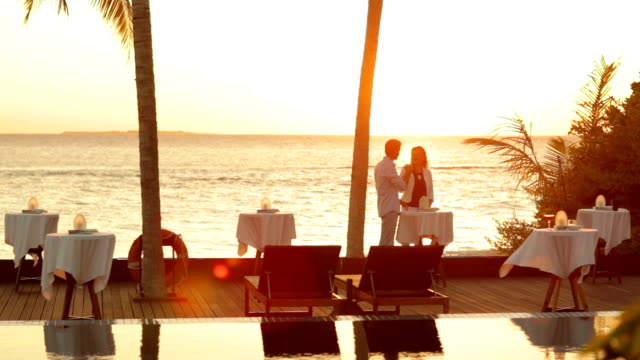 couple at tropical sunset with drinks video