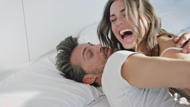 couple awaking - letto video stock e b–roll