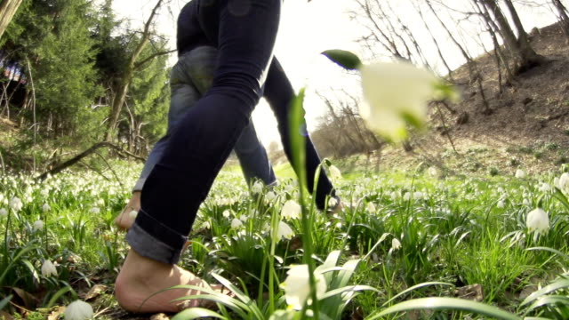 HD SUPER SLOW-MO: Couple Barefoot Walking In The Grass video
