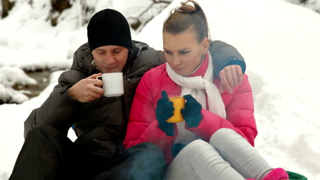 Couple Basking By The Fire In Winter Forest video