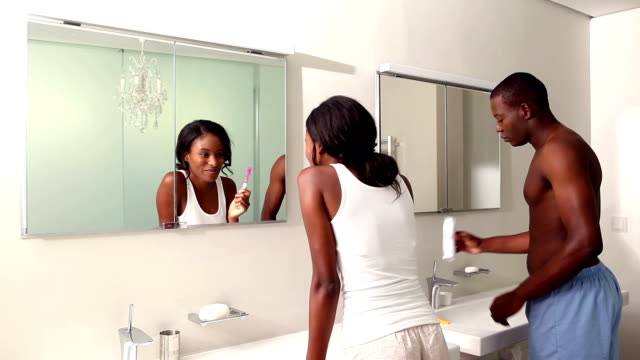 Couple brushing their teeth together video