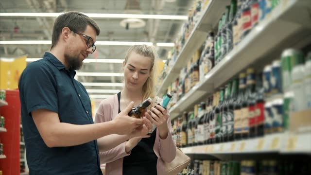 Couple buying beverages in store.