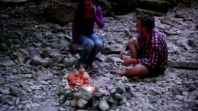 Couple by campfire video