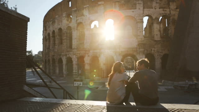 Couple by the Coliseum at sunset video