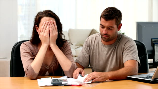 Couple calculating their bills video