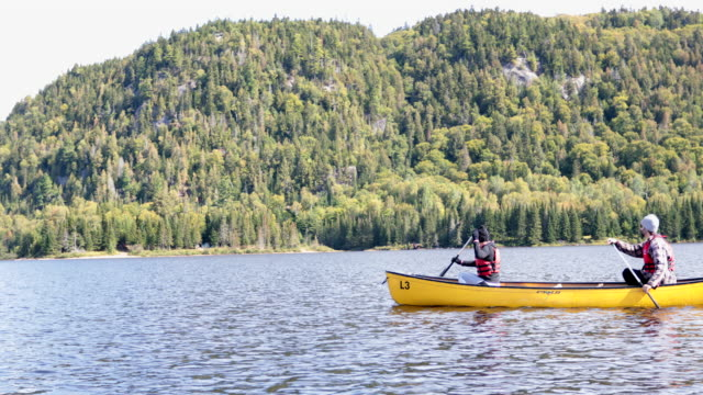 Couple Canoeing at Parc National du Mont-Tremblant, Quebec, Canada