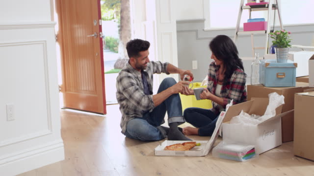 Couple Celebrating Moving Into New Home Shot On R3D video