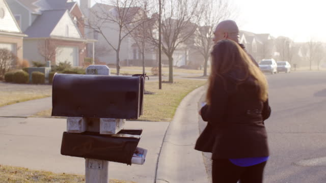 Couple checks mailbox in Mid West suburb video