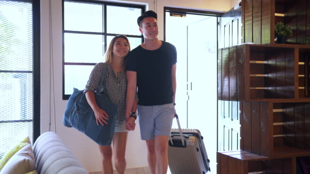 Couple coming to a rented property Couple entering their vacation house for the first time house rental stock videos & royalty-free footage