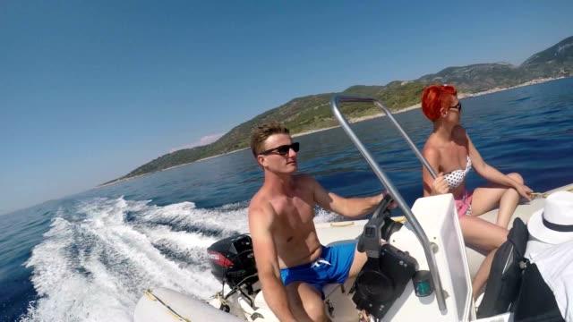 SLO MO POV Couple cruising along the island video
