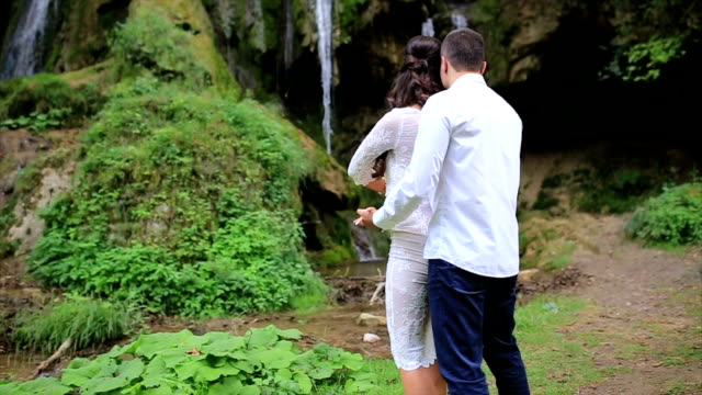 Couple Dancing By Waterfall video