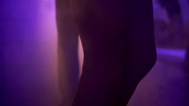 SLO MO MEDIUM SHOT Couple dancing in nightclub video