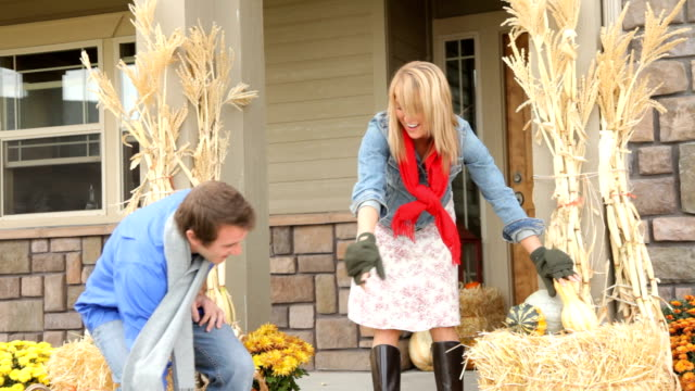 Couple decorates porch in Fall HD 1080p: Couple decorates porch in Fall porch stock videos & royalty-free footage
