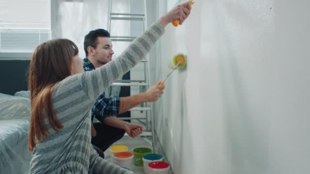 par utsmyckning lägenhet - painting wall bildbanksvideor och videomaterial från bakom kulisserna
