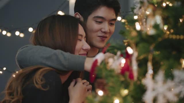 Couple decorating christmas tree