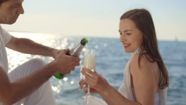 HD: Couple Drinking Champagne At Sunset video