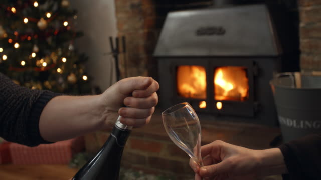Couple Drinking Champagne In Room Decorated For Christmas video