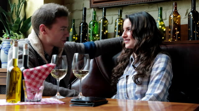 Couple drinking wine in cafe video