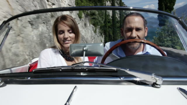 Couple driving cabriolet collection video