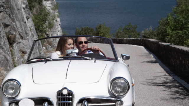 Couple driving cabriolet video