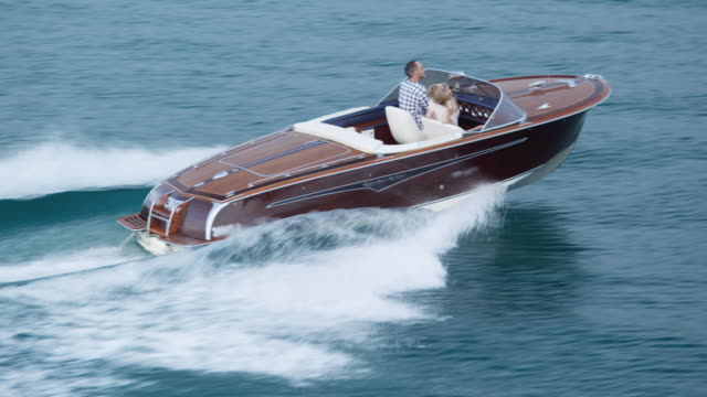 Couple driving on yacht video