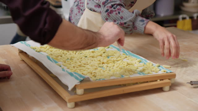 Couple drying pasta at cooking class