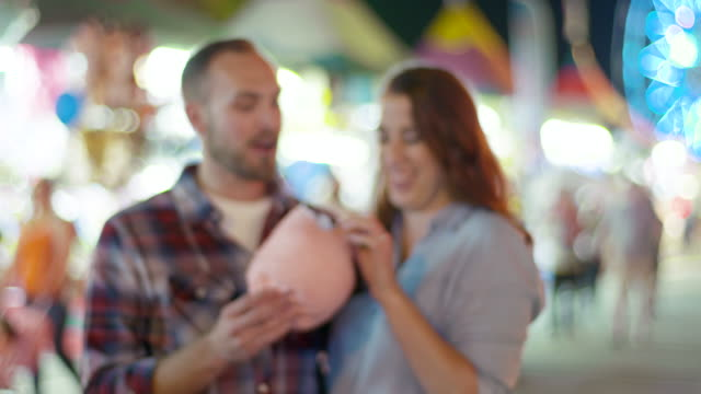 Couple Eating Cotton Candy at Carnival video