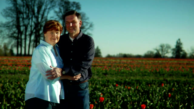 Couple Embrace in Tulip Farm video