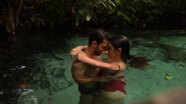 Couple embracing in river