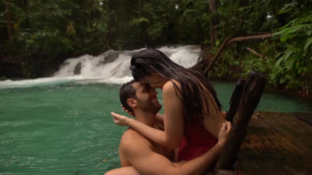 Couple embracing in Waterfall