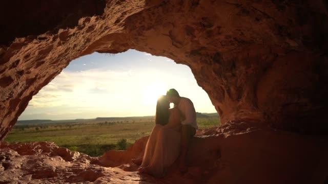 Couple embracing on beautiful sunrise in a rural scene