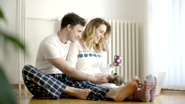 hd: couple enjoy in pajams with their dog at home. - heterosexual couple stock videos and b-roll footage
